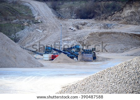 Gravel Pit Machines in a dusty Gravel Pit - stock photo