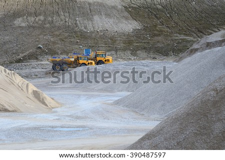 Gravel Pit Trucks in a dusty Gravel Pit