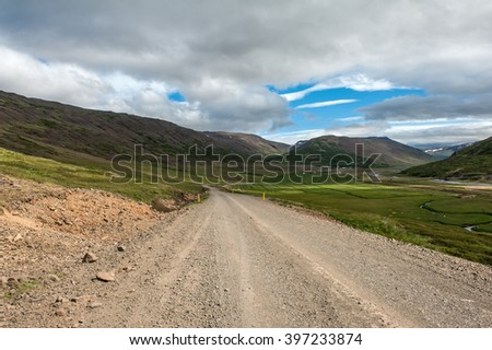 Gravel road between the fjords, Iceland  - stock photo