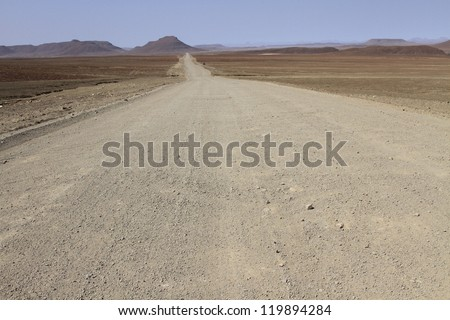 Gravel road in Skeleton Coast Park. Namibia - stock photo