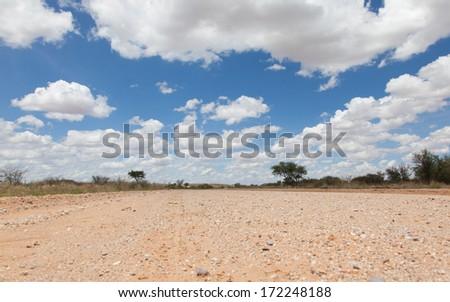 Gravel road in the Namib desert, Namibia - stock photo