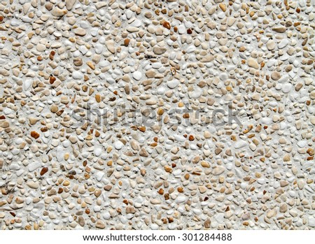 Gravel stone wall background  - stock photo