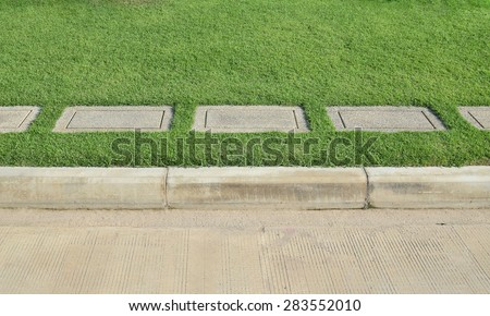 Gravel texture and strip grass with concrete road as background - stock photo