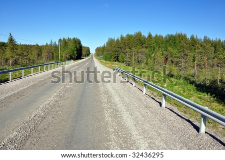 gravelroad in northern Sweden - stock photo