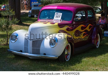 Gravenhurst, Ontario - June 18, 2016: Colorfully painted Vintage Ford Coach 2-Door car from 1940, displayed during the annual Gravenhurst car show - stock photo