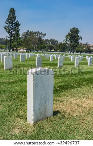 Graves in Los Angeles Military Cemetery stretch out in rows of headstones.