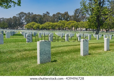 Graves marked by white headstones in Los Angeles National Military Cemetery. - stock photo
