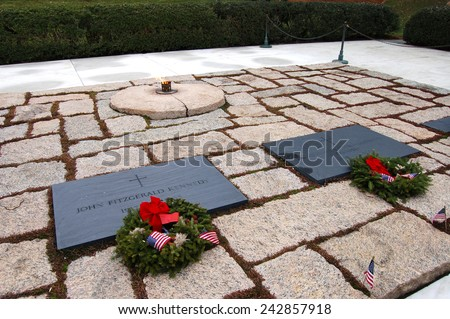 Graves of President John F. Kennedy and his wife, Jacqueline, at Arlington National Cemetery in Arlington, VA. - stock photo