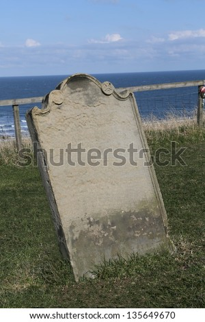 Gravestone at St Mary's church, Whitby, England, setting for the early chapters of Dracula by Bram Stoker. - stock photo