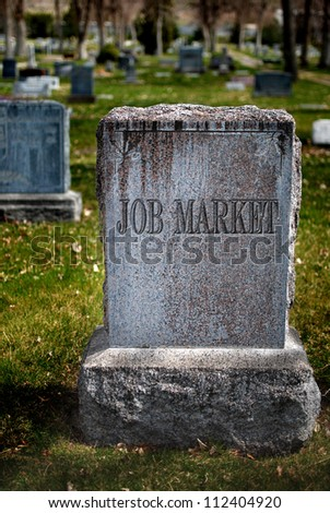 Gravestone in cemetery for job market and employment - stock photo