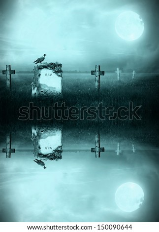 Gravestone in moonlight reflecting in a lake