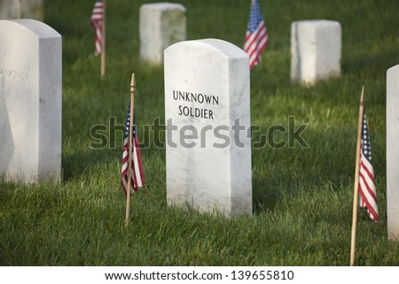 Gravestone of an unknown soldier in Arlington National Cemetery on Memorial Day - stock photo