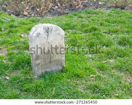Gravestone on grass field
