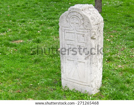 Gravestone on grass field - stock photo