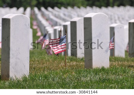 Gravestones decorated with U.S. flags to commemorate Memorial Day at the Arlington National Cemetery in Arlington, Virginia, near Washington DC - stock photo