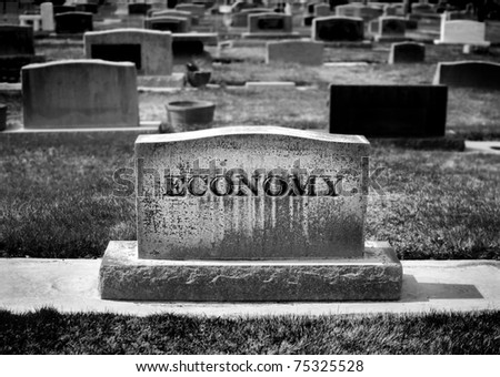 Graveyard and headstone or grave stone with economy carved as the name - stock photo
