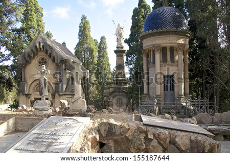 Graveyard of artists and politics in Barcelona. The cemetery and its monuments fall into several artistic and creative era. His early monuments are inspired by classical and Gothic style. - stock photo