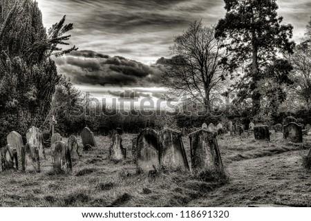 Graveyard sunset black and white - stock photo