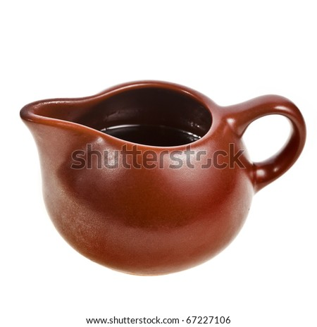 gravy boat bowl  with  sauce isolated on white - stock photo