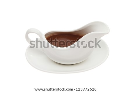 Gravy in a gravy boat isolated against white - stock photo