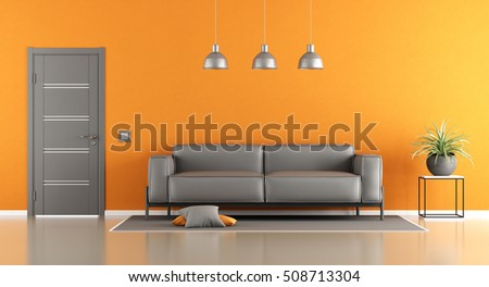 Gray and orange living room with modern sofa and closed door - 3d rendering