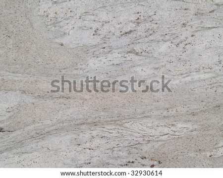 Gray and tan spotted marbled grunge texture. - stock photo