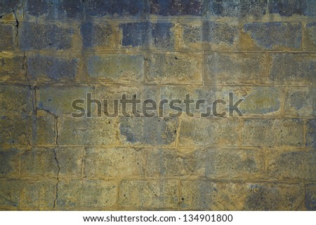 Gray and yellow cinder block wall background - stock photo