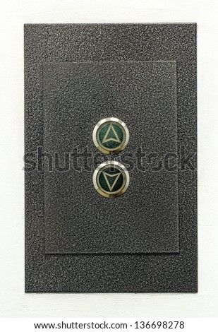 Gray bar and elevator buttons on the white wall, up - down - stock photo