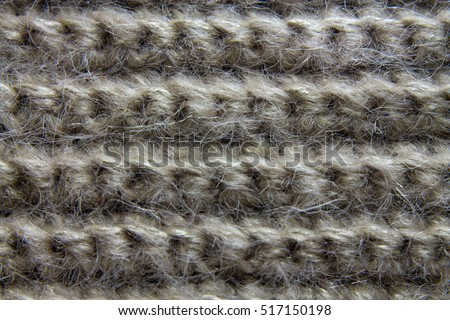 gray, beige knitted fabric made of mohair. texture