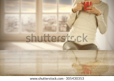 gray board woman with red mug and space for you