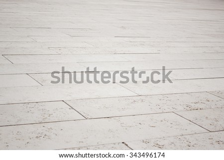 Gray brick stone street road. Light sidewalk, pavement texture - stock photo