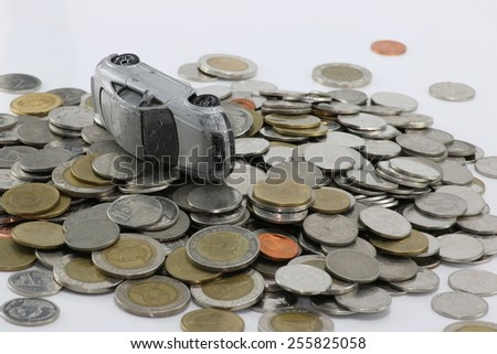 Gray car accident on a pile of money white background. to pay damages. - stock photo