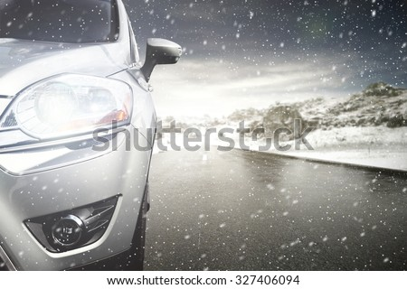 gray car and winter road  - stock photo