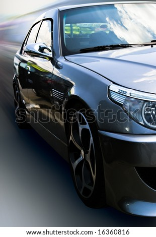 gray car with cloud reflection isolated with clipping path - stock photo