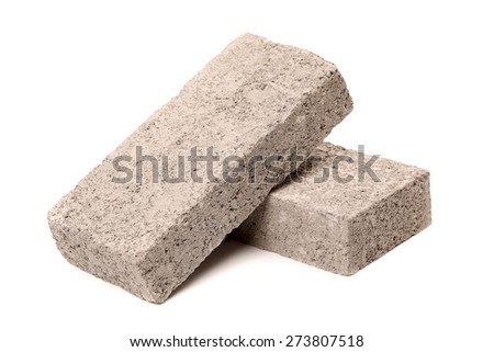 Gray cement solid brick isolated on a white background