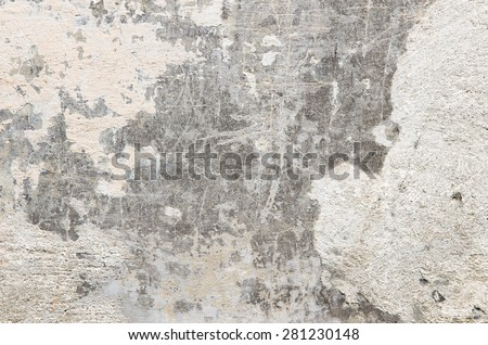 Gray cement wall with traces of crumbling plaster. textural composition - stock photo