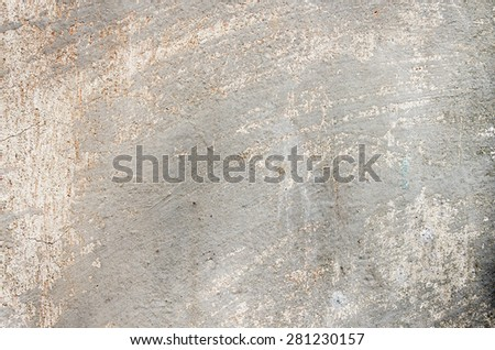 Gray cement wall with traces of the brush on the crumbling plaster and small cracks. textural composition