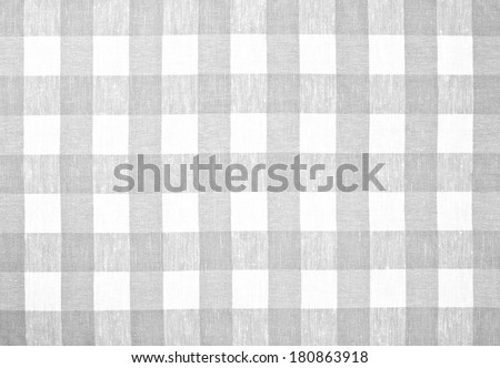 gray checked fabric tablecloth - stock photo