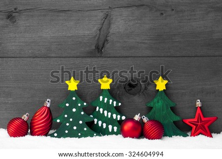 Gray Christmas Decoration On White Snow. Green Christmas Tree And Red Christmas Balls. Brown, Rustic, Vintage Wooden Background For Copy Space. Christmas Card With Snowy Atmosphere. Black And White - stock photo