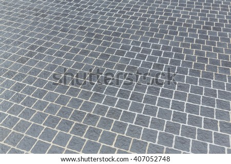 Gray color rough stone floor tiles background, outdoor flooring