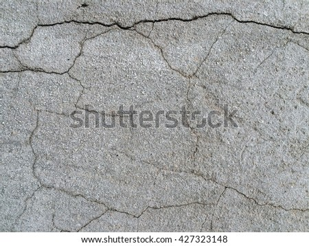 Gray concrete crack wall texture background