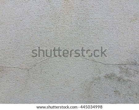 Gray concrete crack wall texture background - stock photo