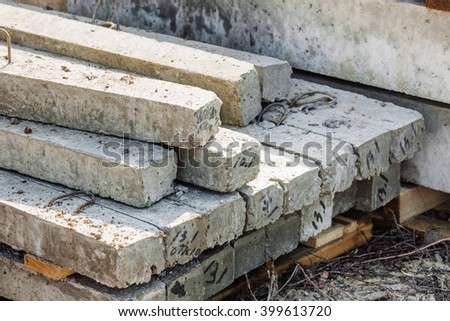 gray concrete pillars blocks on building materials warehouse . Construction and building concept. - stock photo