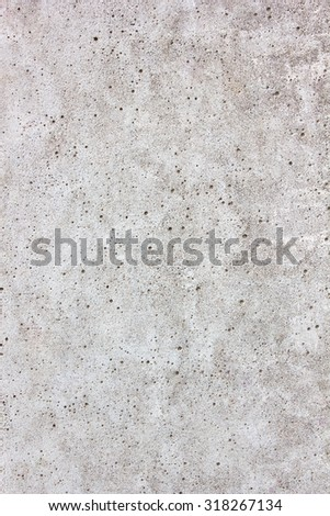 Gray concrete wall close-up good for patterns and backgrounds.