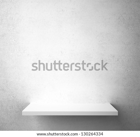 gray concrete wall with shelf - stock photo