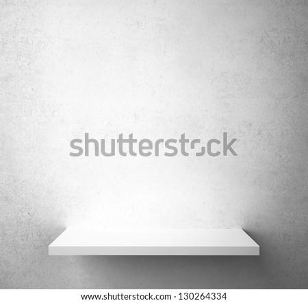 gray concrete wall with shelf - stock photo