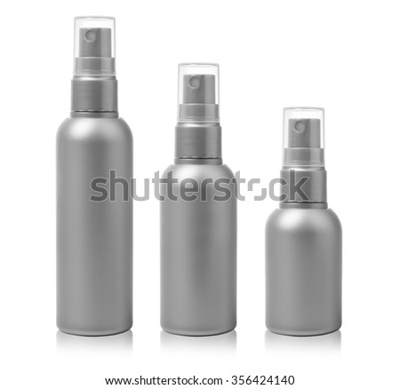 Gray cosmetic spray bottles set isolated on white background - stock photo