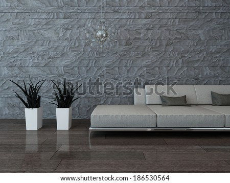 Gray couch against stone wall - stock photo