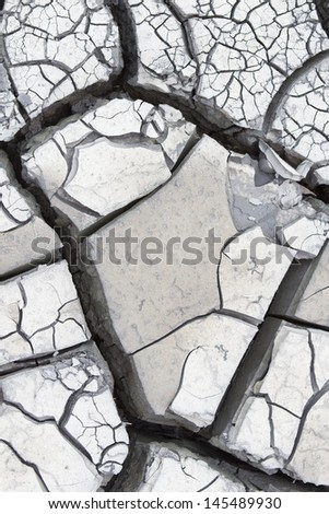 Gray cracked dry mud, outdoor extreme close up shoot - stock photo