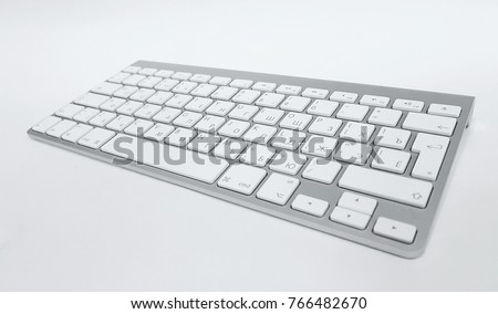 Gray Cyrillic keyboard on white table